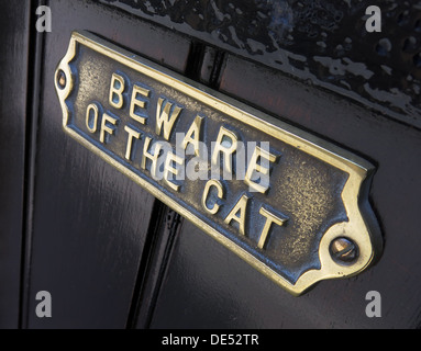 Beware of the cat sign on a door - Stock Image