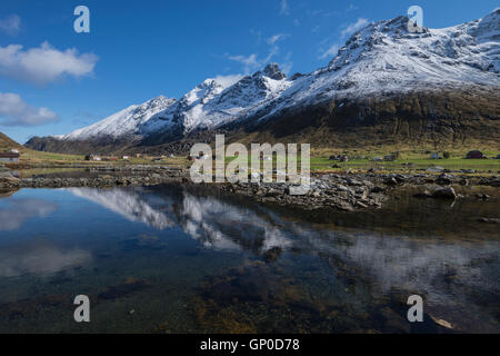 Spring snow mountain reflection in Skjelfjord, Flakstadøy, Lofoten Islands, Norway - Stock Image