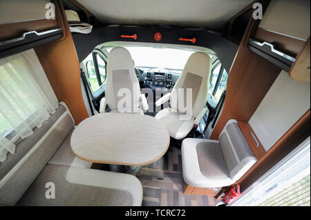 Camper Cabin Interior With Rotating Seats in Recreation Vehicle - Stock Image
