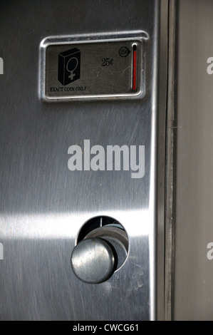 Condom dispenser at women's bathroom - Stock Image