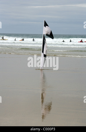 Surfing and Kayaking at Perranporth Beach, North Cornwall Coast, Britain, UK. - Stock Image