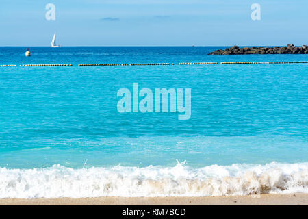 Winter sun travel destination, warm blue ocean swim water on Amadores beach, Gran Canaria, Canary islands, Spain - Stock Image