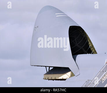 Military cargo jet airplane open nose cargo bay - Stock Image