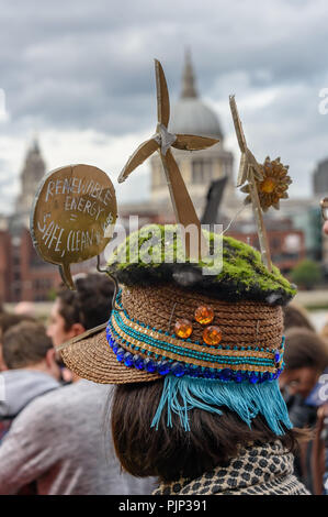 London, UK. 8th September 2018. A hat for renewable energy at the Climate Reality  rally in front of Tate Modern, one of thousands around the world demanding urgent action by government leaders to leaders commit to a fossil free world that works for all of us.  community leaders, organisers, scientists, storytellers and o Credit: Peter Marshall/Alamy Live News - Stock Image