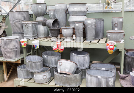 Display of metal planting containers, The Walled garden plant nursery, Benhall, Suffolk, England, UK - Stock Image