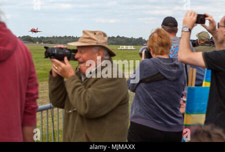 Photographer apparently missing the Red Arrows at Biggin Hill Airshow - Stock Image