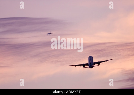 Two passenger jets on in flight - Stock Image