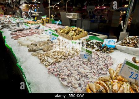 Seafood on display at the Mercat de Sant Josep de la Boqueria (known as La Boqueria) indoor market in Barcelona, Spain - Stock Image