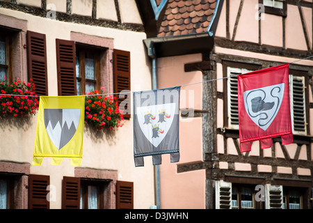 flags in the streets of ribeauville, haut-rhin, alsace, france - Stock Image