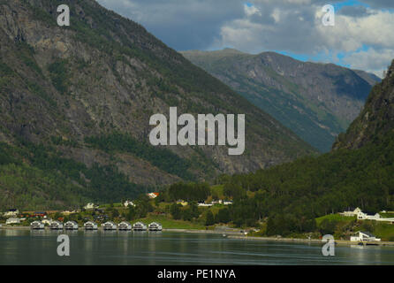 Skjolden, Norway - 6 August 2018: View of the village of Skjolden from the Sogenfjorden fjord. The village is set at the inner end of Sogenfjorden, the world's longest fjord and the deepest in Norway with its sheer vally walls and jagged mountain peaks. Photo: David Mbiyu - Stock Image
