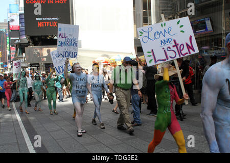 June 15, 2019 - New York, New York, U.S. - New York, NY Human Rights Connection Arts body painted over 100 models in N.Y.C's Times Square as part of their protest against Divisiveness after the models were painted they marched down Broadway to The FlatIron Building on 23rd Street and formed a song circle to finish the days protest. (Credit Image: © Bruce Cotler/Globe Photos via ZUMA Wire) - Stock Image