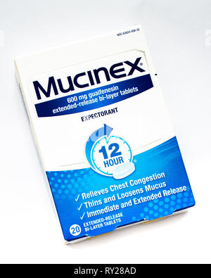 A package of Mucinex extended release bi-layer tablets to relieve chest congestion, thin and loosen mucus. - Stock Image
