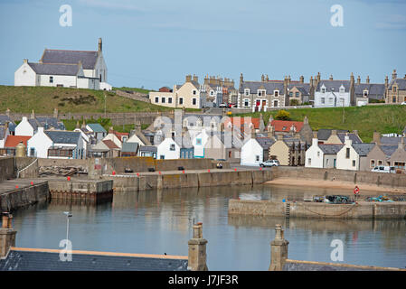 Findochty harbour with the town and Church  beyond. - Stock Image