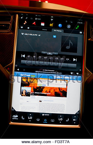 Heads Up display showing a Facebook page in Web browser in a Tesla Motors electric car  access to internet - Stock Image