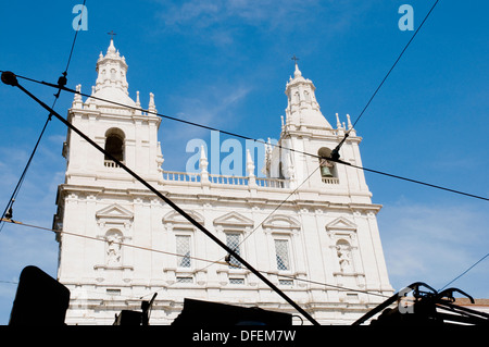 The electric cables that power Lisbon's tram cars silhoutted against the facade of the São Vicente de Fora church, in Alfama. - Stock Image
