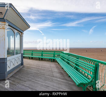 A bench, footpath and building on St Annes on Sea Pier - Stock Image