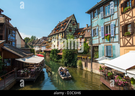 Canal with boat in old medieval town centre of Colmar, Framce - Stock Image