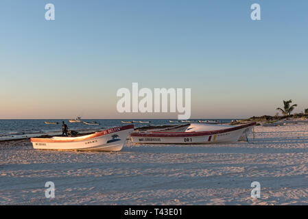 fishing boats at sunrise at playa pescadores in tulum mexico - Stock Image