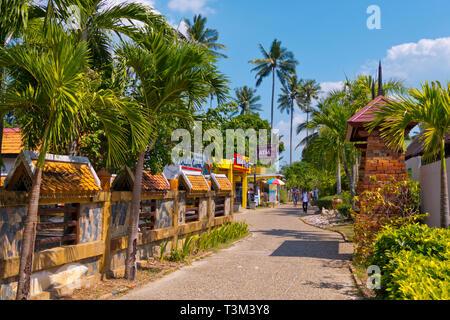Walking street, inland promenade, between floating pier and Railay West beach, Railay, Krabi province, Thailand - Stock Image
