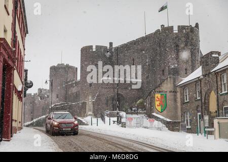 Pembrokeshire, Wales, 2nd March 2018. A rare snow filled scene at Pembroke Castle, Pembroke town in Pembrokeshire, - Stock Image