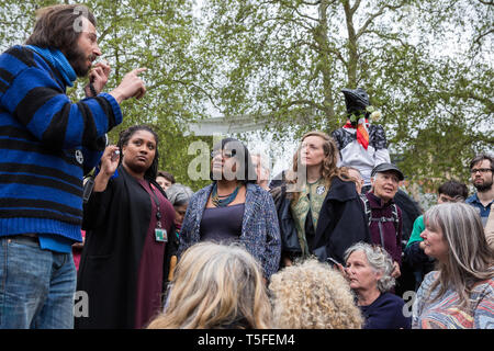 London, UK. 24th April 2019. George Barda asks a question to Diane Abbott MP, Shadow Home Secretary, at an assembly of climate change activists from E - Stock Image