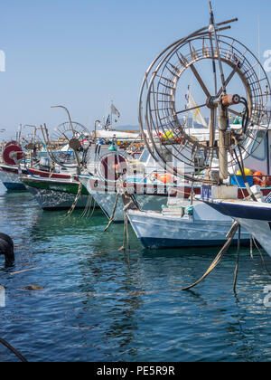 Cypriot fishing boats in turquoise water - Stock Image