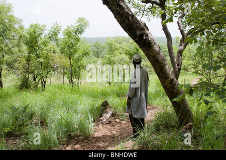 Hunter Moussa at the edge of the Nyankamba Escarpment, reached from Sor 2, Ghana. - Stock Image