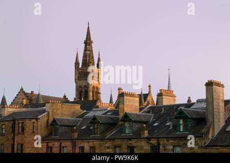 Glasgow University tower and west end rooftops bathed in warm Autumn evening sunlight in Glasgow, Scotland, UK, Europe - Stock Image