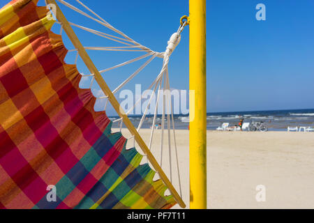 Colored hammock on the beach in Jurmala. Latvia - Stock Image