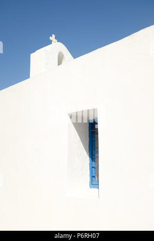 Very old Church on the Island of Kea with tiny windows and small cross standing above the bell tower, Greece, Europe. - Stock Image