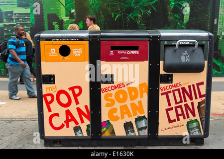 Manhattan, New York, U.S. - May 21, 2014 -  In Times Square is a solar powered 3 bin recycling system, for plastics, bottles and cans, and trash. - Stock Image