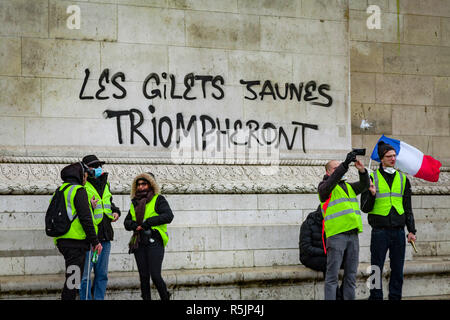 Paris, France. 1st December, 2018.  'Yellow vests will win' on the walls of Arc de Triomphe during the Yellow Vests protest against Macron politic. Credit: Guillaume Louyot/Alamy Live News - Stock Image