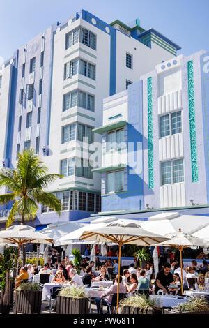 Miami Beach Florida Ocean Drive New Year's Day Art Deco District Park Central Casablanca Hotel sidewalk cafe restaurant umbrel - Stock Image
