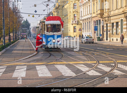 Santa boarding Santa Claus' tram, as part of the Advent Market celebration in Zagreb, going through the streets of the capital> - Stock Image