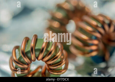 Macro-photo of toroidal copper wired RF chokes from printed circuit board (PCB) - Stock Image