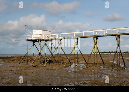 boardwalk made of wood during low tide on a beach near La Rochelle (France) - Stock Image