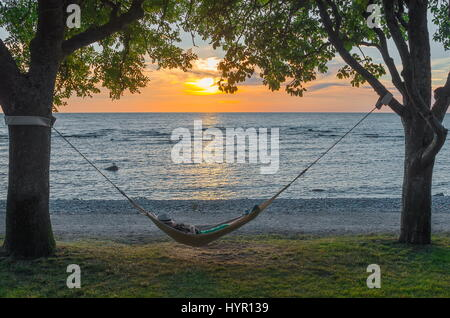 Hammock in Sunset - Stock Image