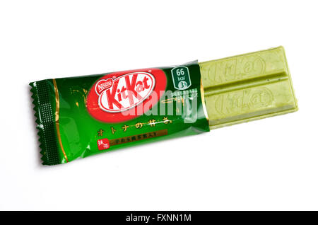 Unusual Japanese Kitkat flavours. Matcha green tea flavour showing the green chocolate. - Stock Image