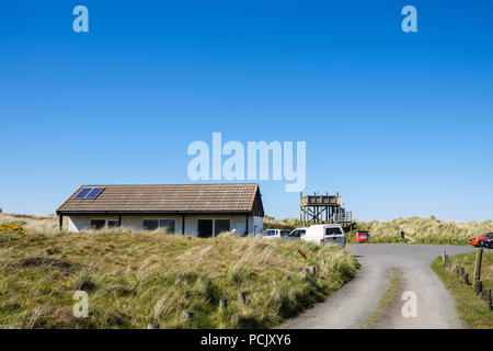 Manx Wildlife Trust Ayres Visitor Centre building carpark and raised viewing plantform in National Nature Reserve on north coast. Ramsey, Isle of Man - Stock Image