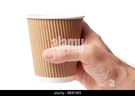 Cardboard cup of coffee in a human hand on white with a clipping path. - Stock Image