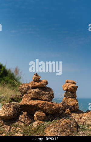 Stack of stones in Phuket with Andaman sea behind, Thailand - Stock Image