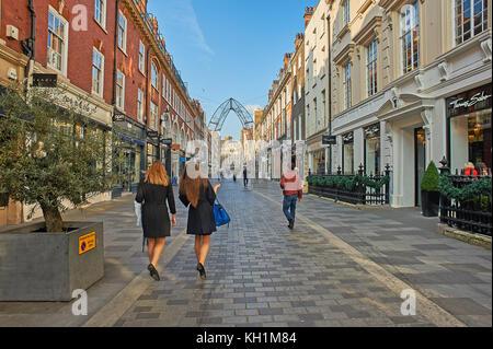 Two women walking along a pedestrianized street in London's West End - Stock Image