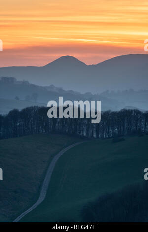 Powys, UK. Sunset over the peaceful Radnorshire countryside near Presteigne in mid-Wales, looking towards the conical hill known as the Whimble - Stock Image
