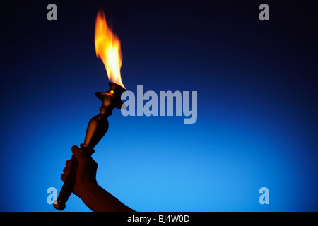 Olympic Torch with Dark Blue Sky at Dusk - Stock Image