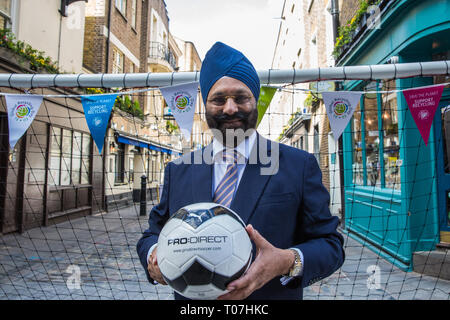 London, UK. 18th March, 2019. Ranjit Baxi, Founding President of the Global Recycling Foundation, prepares to take part in the Recycling Goals football challenge to mark the celebration of the second annual Global Recycling Day. The challenge is a social media movement that harnesses the power of football to inspire long term recycling habits in young people across the world. Credit: Mark Kerrison/Alamy Live News - Stock Image
