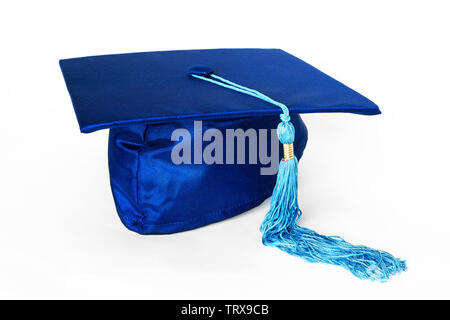 Blue graduation cap or mortarboard with blue tassel isolated on white background. - Stock Image