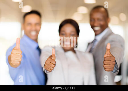 closeup portrait of business team giving thumbs up - Stock Image