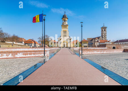 View to the Bell tower from Coronation Reunification Cathedral and to the Roman-Catholic Cathedral Saint Michael in Alba Iulia city, Romania. - Stock Image