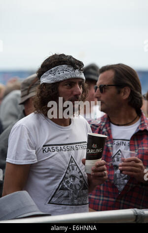 Southsea, UK. 24th Aug, 2014. Victorious Festival - Sunday, Southsea, Hampshire, England. A fan in a band t-shirt - Stock Image