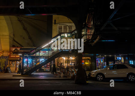 Astoria, New York, USA - 13 March 2018 - 31st Street under the Ditmars Blvd Elevated Subway Station at night. ©Stacy - Stock Image